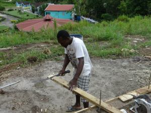 The Jamaican way involves a lap joint when we splice the sill plate. Notice the lap joint made with a machete.